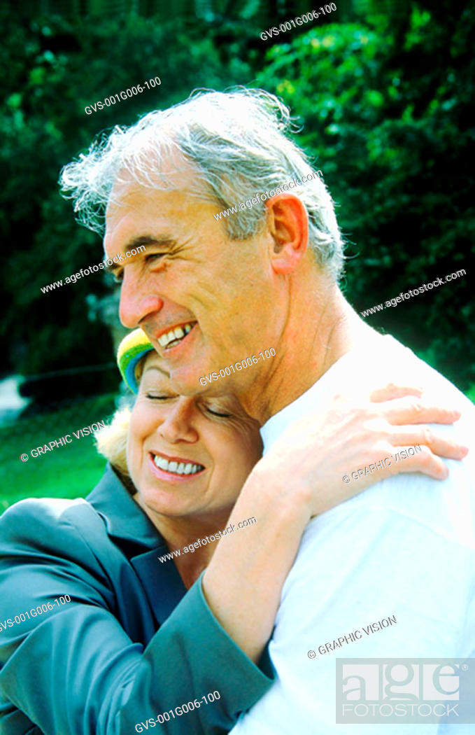 Stock Photo: Portrait of a mature couple hugging and smiling.