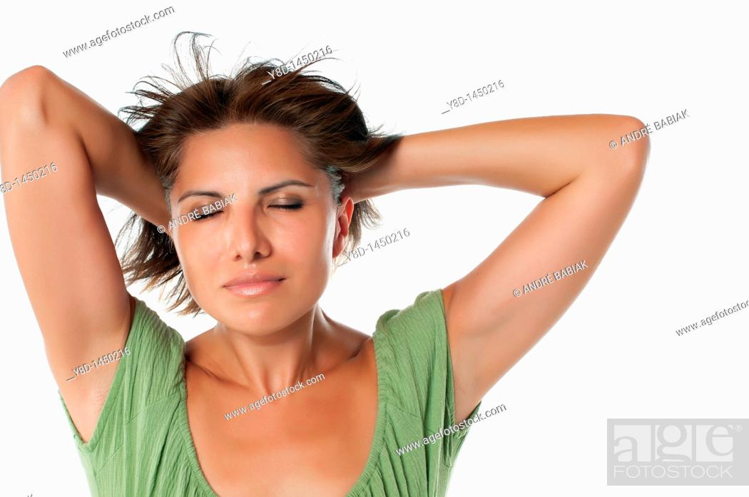 Stock Photo: Portrait of attractive mature hispanic woman relaxing with eyes closed.