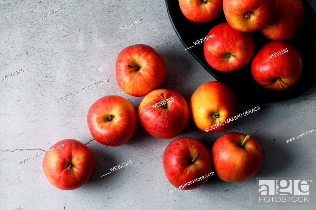 Photo de stock: Red apples on stone background.