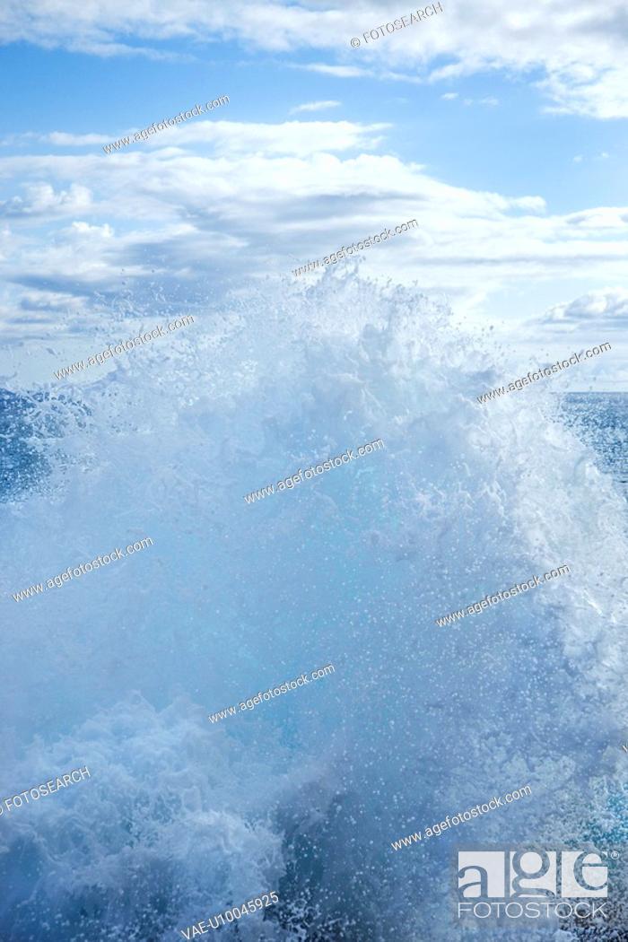 Stock Photo: Wave splashing water.