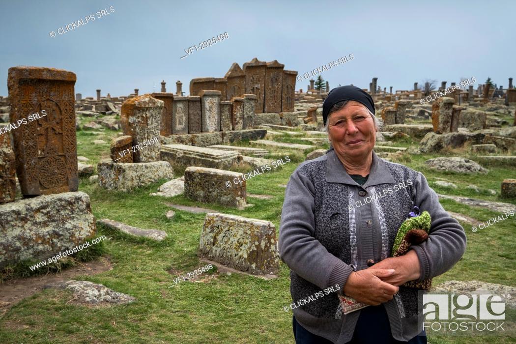 Stock Photo: Armenian woman in the historical cemetery of Noratus near Lake Sevan, Armenia, Caucaus, Eurasia.