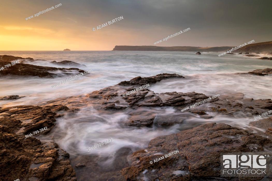 Stock Photo: Waves swirl over rocky ledges at sunset on the North Cornwall coast, Cornwall, England, United Kingdom, Europe.