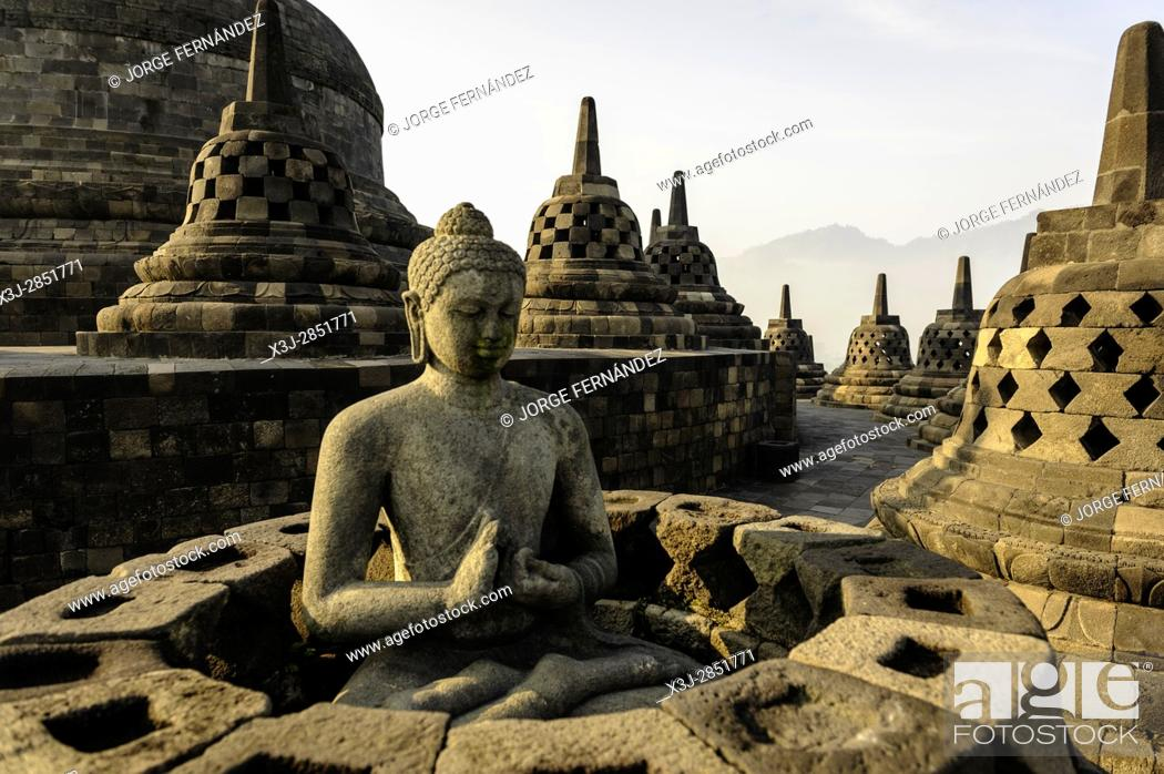 Stock Photo: Statue of Budha in the famous temple of Borobudur.