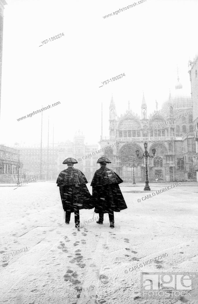 Stock Photo: Carabinieri in San Marco square during a snowstorm - Venice Italy.