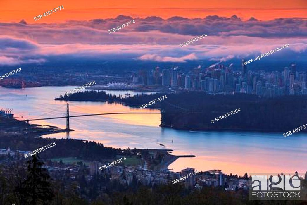 Stock Photo: Canada, British Columbia, Vancouver, View of Lions Gate Bridge from Stanley Park at dusk.