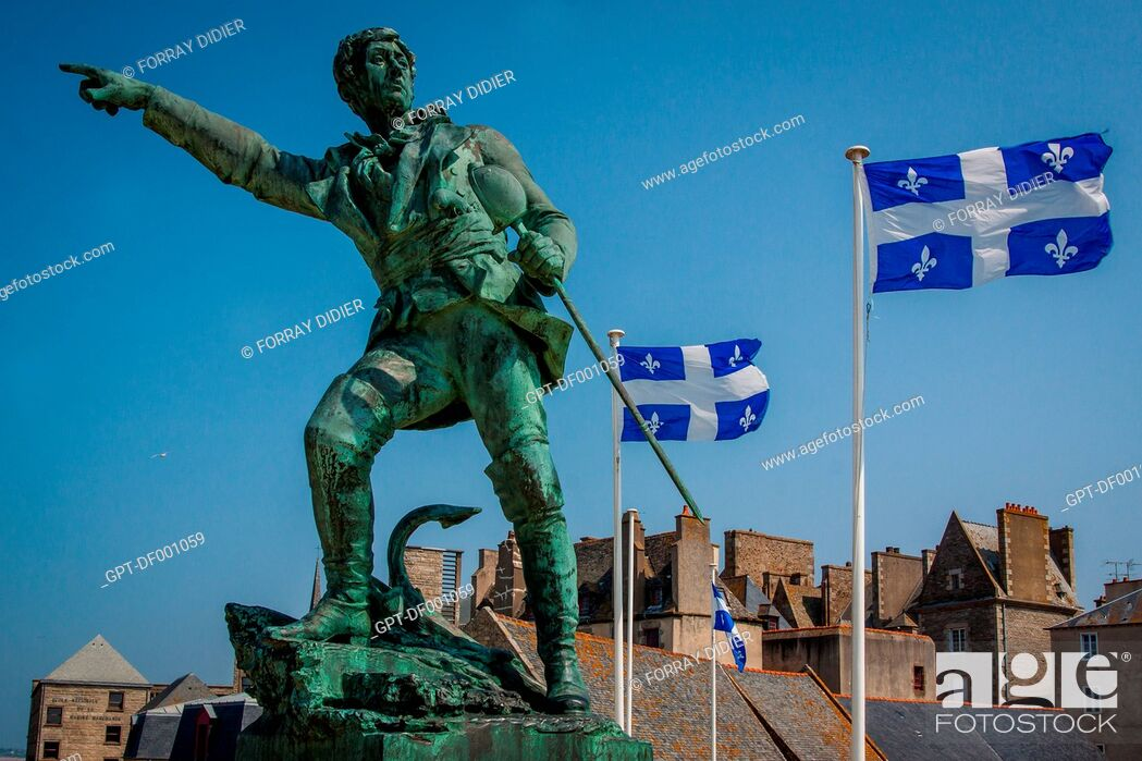 Stock Photo: STATUE OF THE CORSAIR FROM SAINT-MALO, ROBERT SURCOUF, ON THE RAMPARTS OF SAINT-MALO HISTORIC CENTER, THE OLD TOWN, QUEBEC FLAG RECALLS THE HISTORIC TIES.