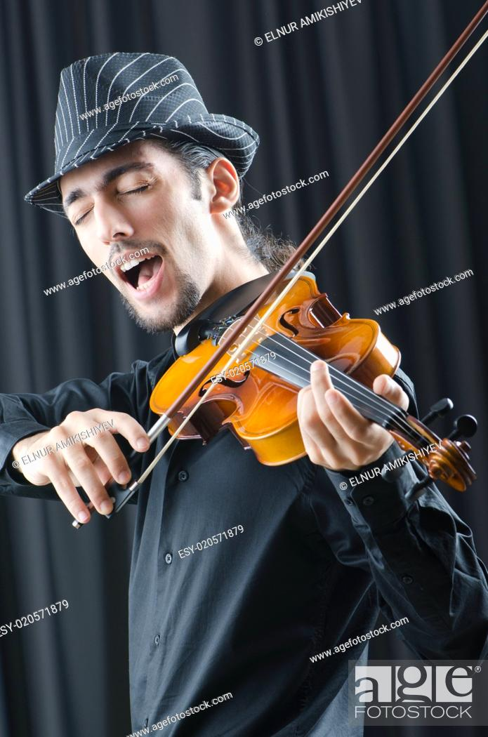 Stock Photo: Fiddler playing the violin.