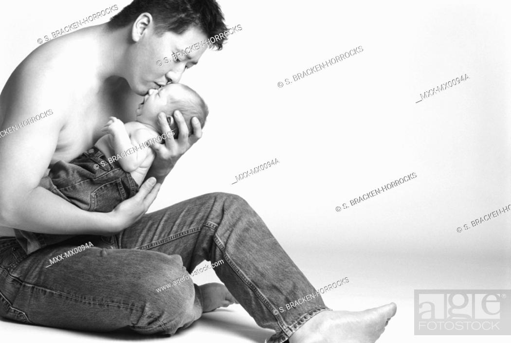 Stock Photo: Asian man holding baby.