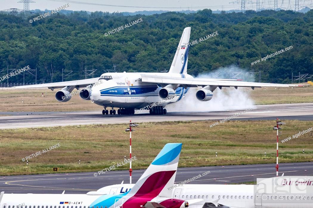 Stock Photo: 22 May 2020, North Rhine-Westphalia, Duesseldorf: An Antonov AN-124 cargo plane lands at Düsseldorf airport. Around 6.6 million face masks were flown from.