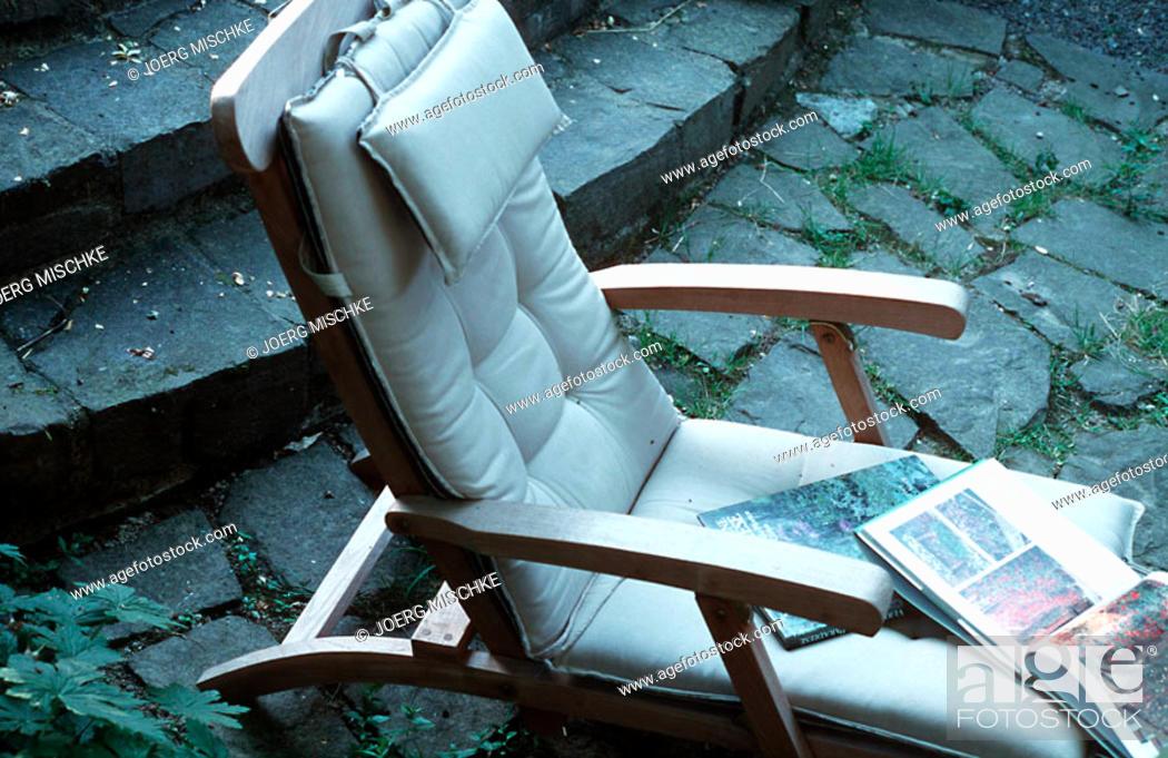 Stock Photo: A comfortable deckchair in the garden.