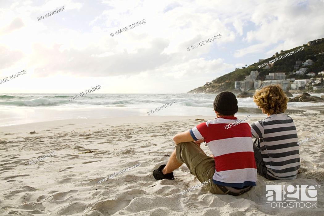 Stock Photo: Two boys sitting on beach.