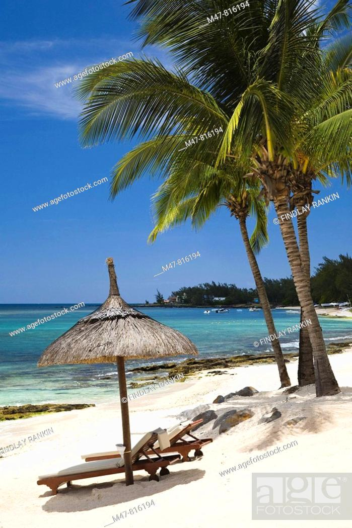 Stock Photo: Beach in Mauritius with view over Indian Ocean with shade umbrella and two beach beds.