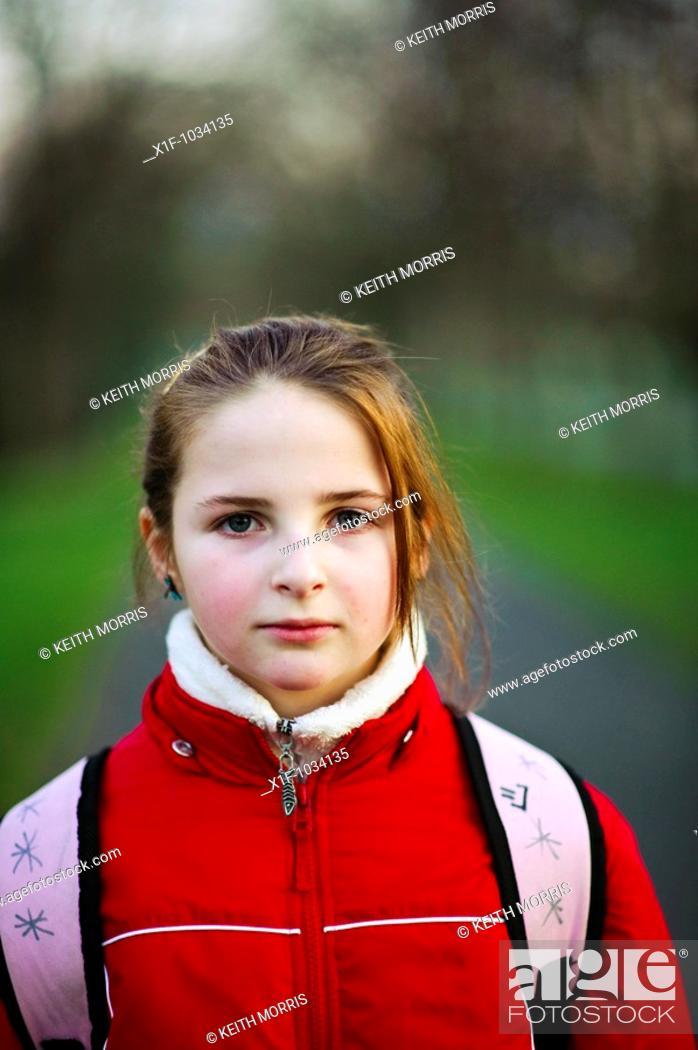 Stock Photo: Ten year old girl, looking straight ahead, UK.