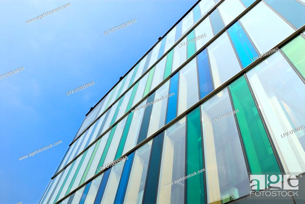 Stock Photo: Abstract detail of office building with tinted glass cladding.