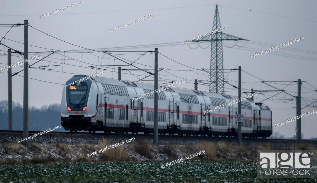 Stock Photo: 24 January 2019, Saxony, Leipzig: An IC (IC 2046 Dresden - Cologne) travels in the morning on a free route between Leipzig and Halle (Saale).