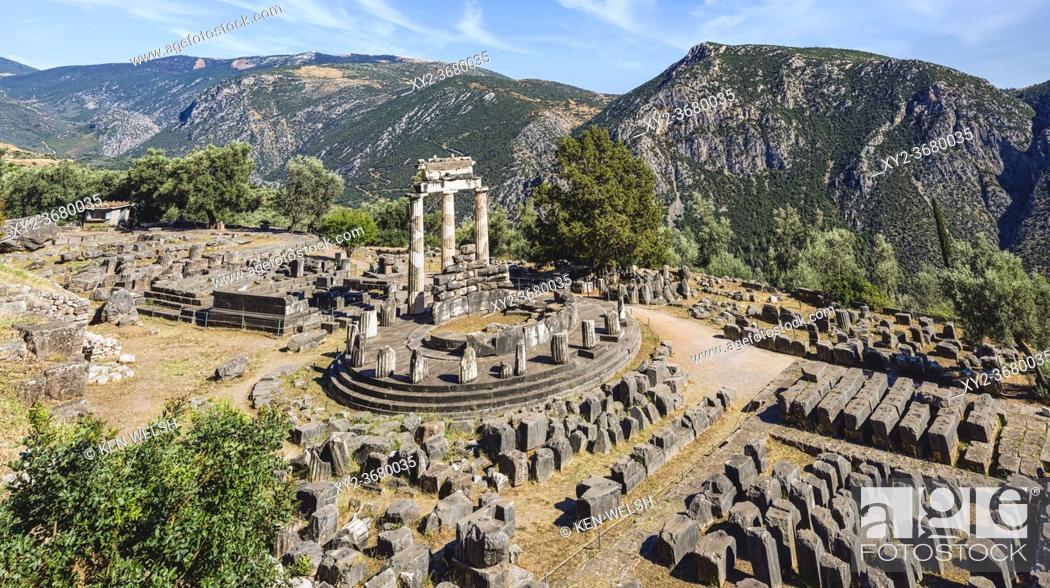 Stock Photo: Delphi, Phocis, Greece. The tholos beside the Sanctuary of Athena Pronaia. Ancient Delphi is a UNESCO World Heritage Site.