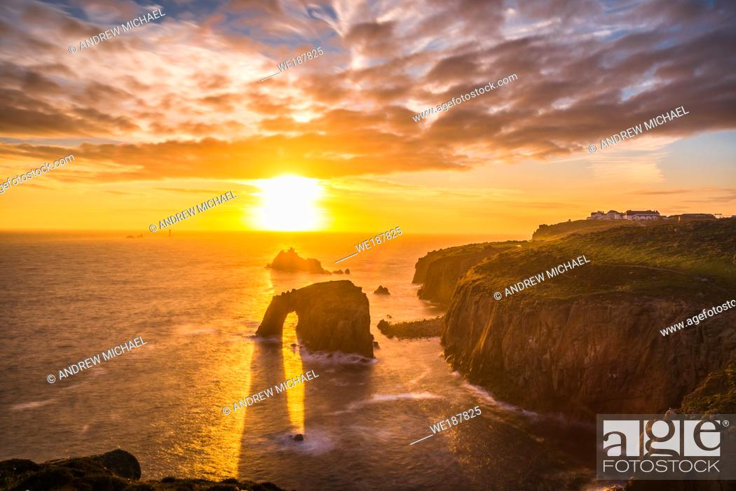Stock Photo: Dramatic sky at sunset with Enys Dodnan and the Armed Knight rock formations at Lands End, Cornwall, England, United Kingdom, Europe.