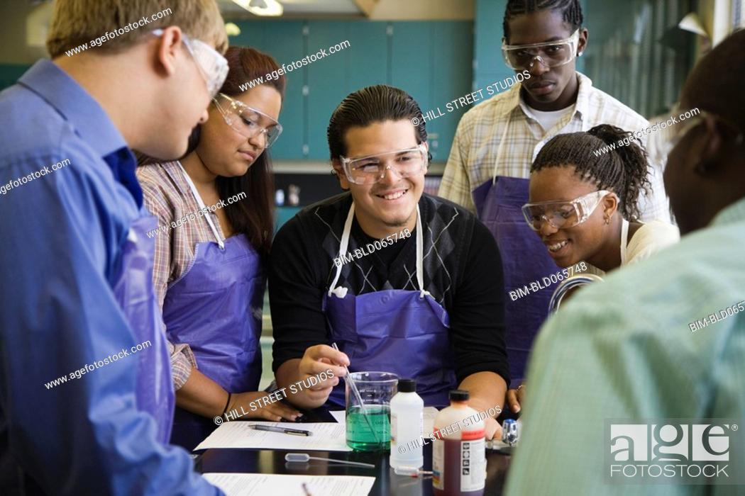 Stock Photo: Students performing experiment in chemistry lab.