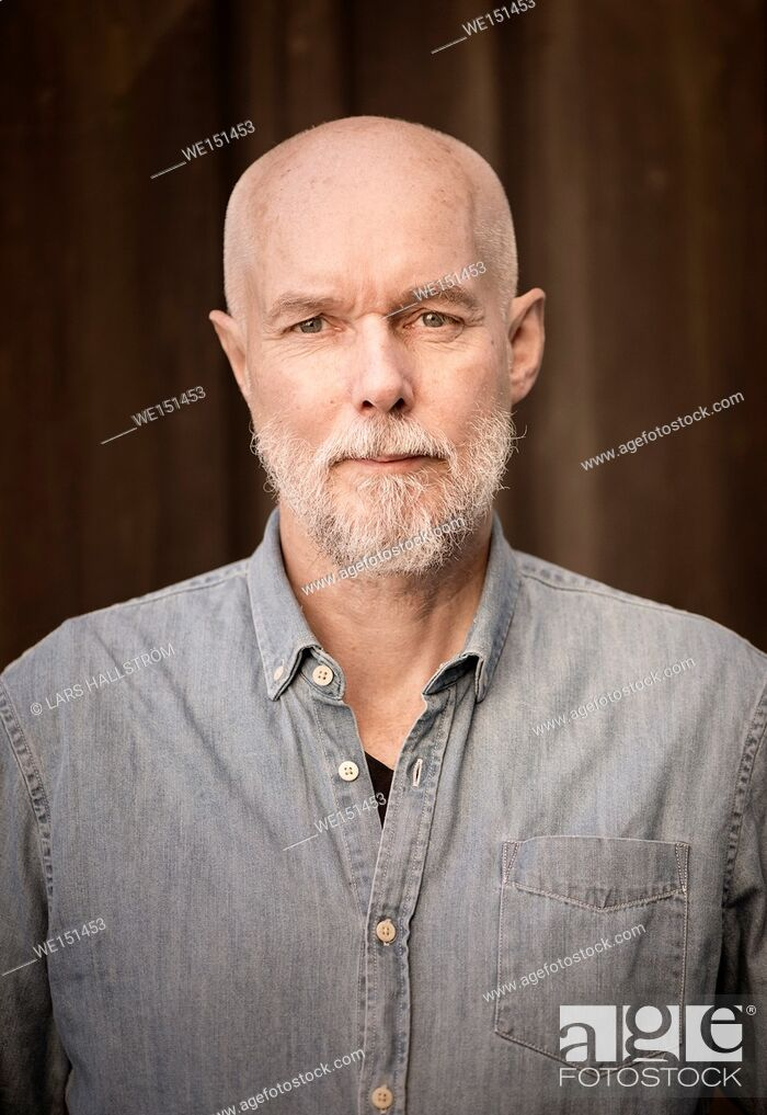 Stock Photo: Portrait of old man looking at camera with serious and determined facial expression.