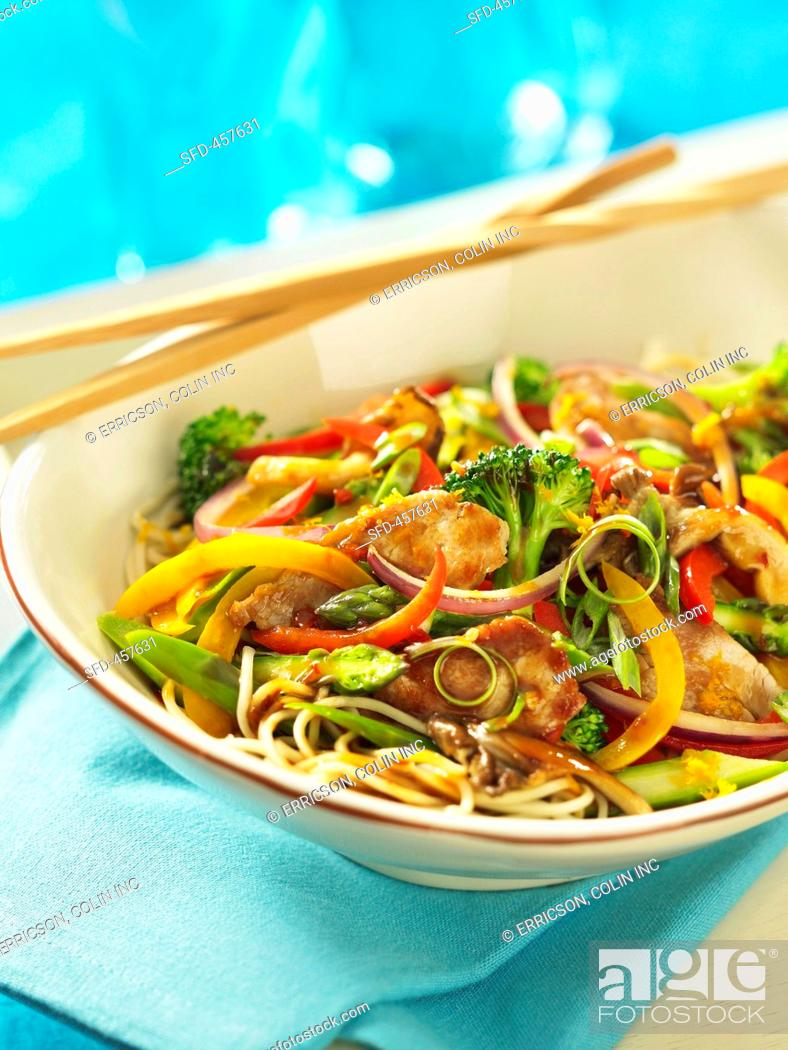 Stir fried pork and vegetables in a spicy orange sauce Asia