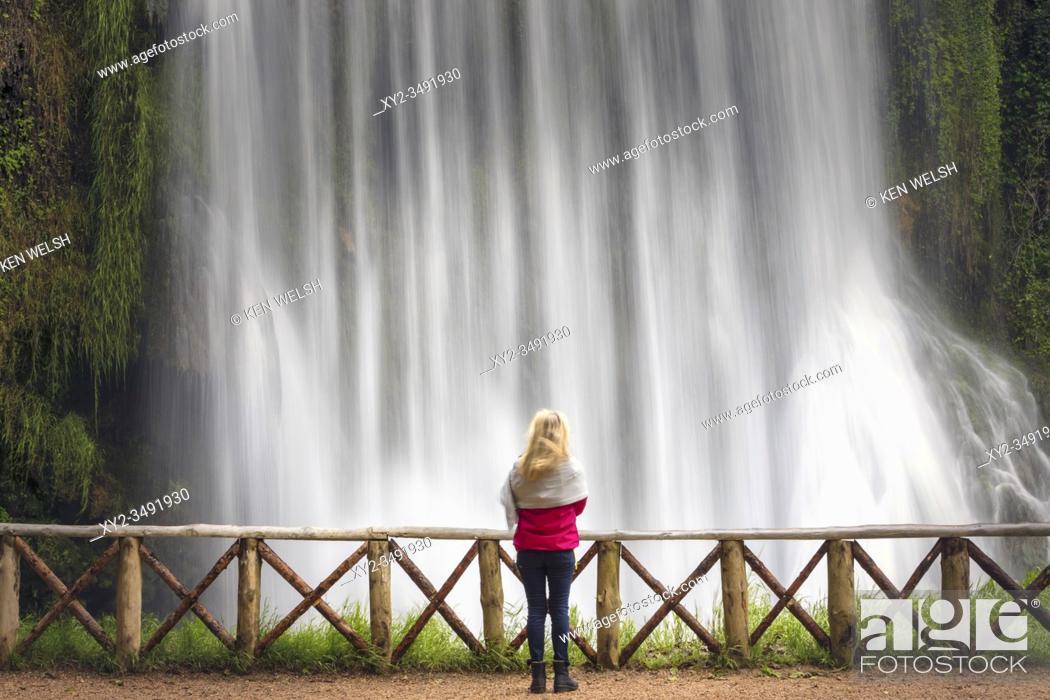 Stock Photo: Woman standing in front of La Caprichosa waterfall in Parque Natural del Monasterio de Piedra, Zaragoza Province, Aragon, Spain.