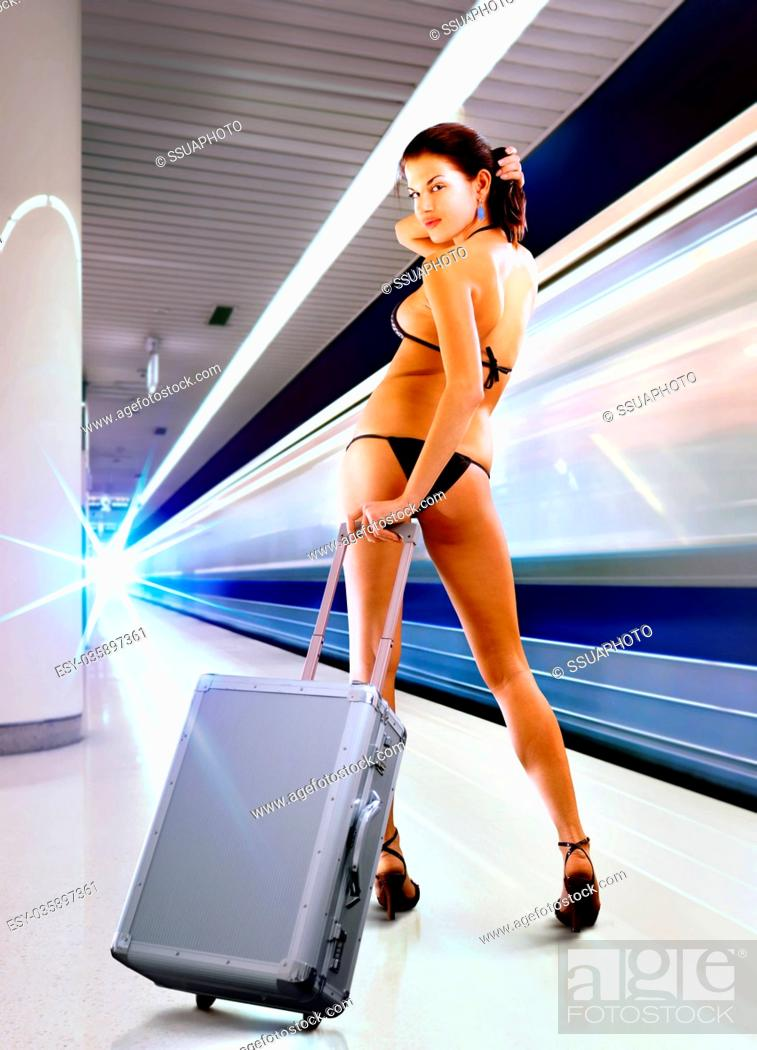 Stock Photo: sexy woman with luggage in subway.