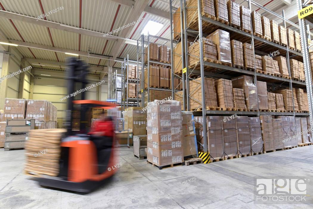 Stock Photo: Moving forklift in factory hall.