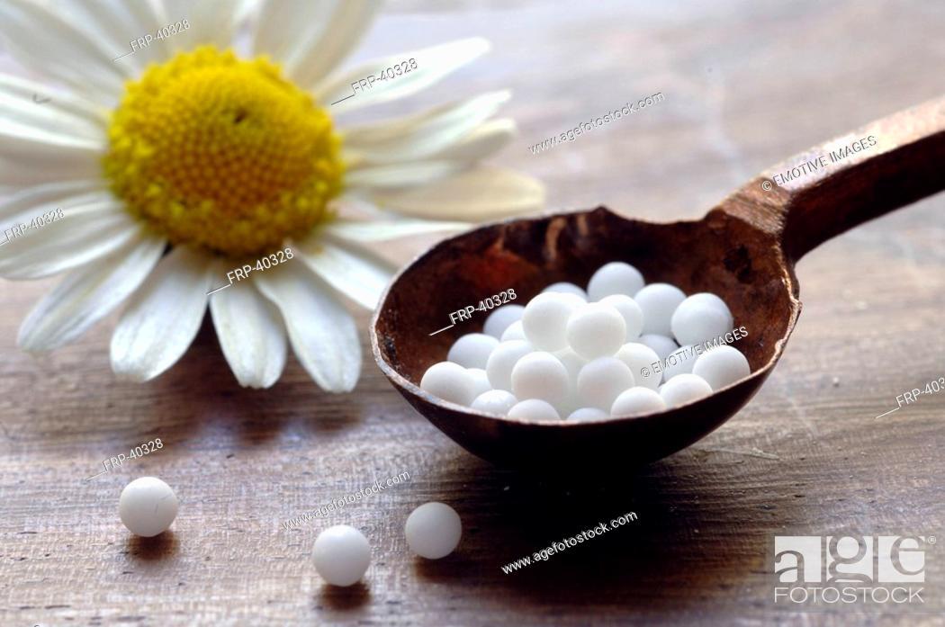 Stock Photo: Globules and chamomilla.