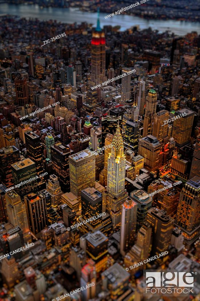 Stock Photo: Chrysler Building NYC Skyline - Aerial view of the Art Deco architecture style of the Chrysler Building a de-focused Empire State Building (ESB) and other.