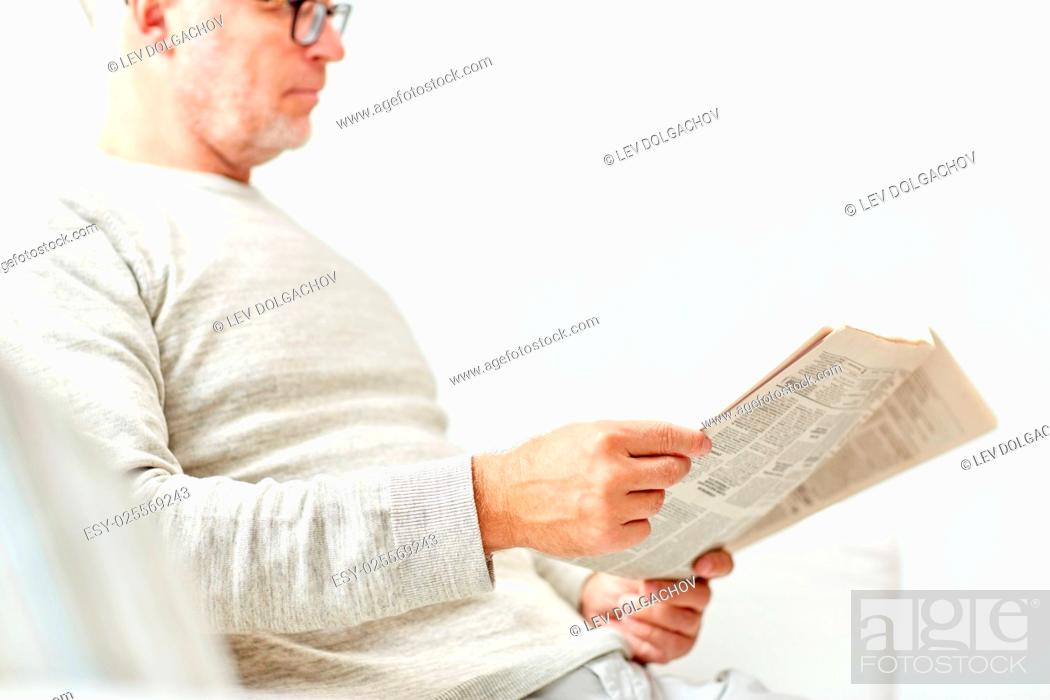 Stock Photo: information, people and mass media concept - close up of senior man reading newspaper.