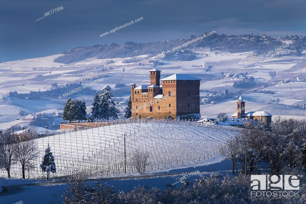 Stock Photo: Grinzane Cavour, Piedmont, Italy View of the Castle, Unesco symbol, illuminated by an evocative beam of light, surrounded by marvelous hills and snowy vineyards.