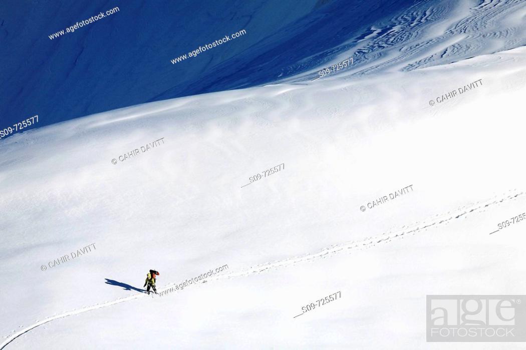 Stock Photo: Lone skier near the Aiguille du Midi cable car station, Les Bossons, Chamonix Mont Blanc, Rhone-Alpes, France.