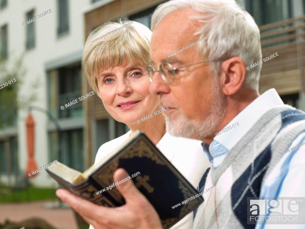Stock Photo: Senior couple with a bible.
