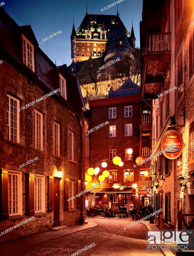 Stock Photo: Q-De-Sac Resto-Pub, Q de Sac restaurant pub by night with colorful lanterns and la Chasse-Galerie boutique at Rue du Cul de Sac street in old Quebec City.