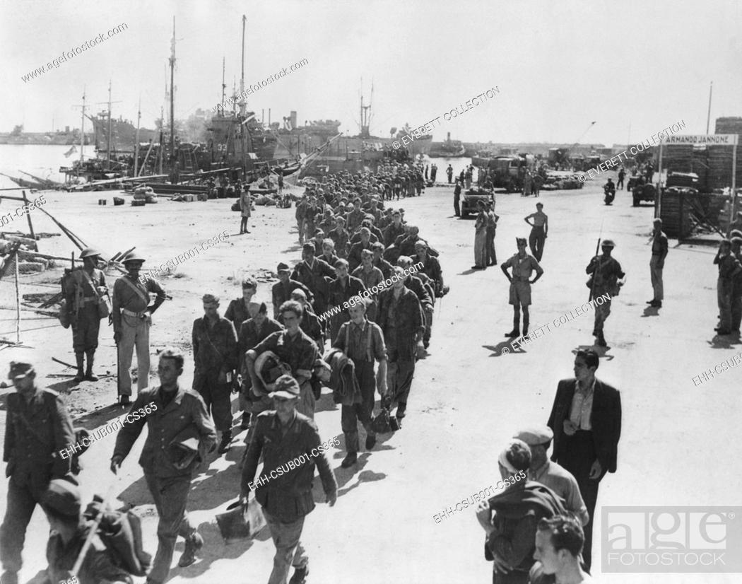 Stock Photo: German prisoners, were captured on seacoast town in Italy, on their way to a POW stockade. Photo was made when Navy Secretary Frank Knox was touring the Italian.