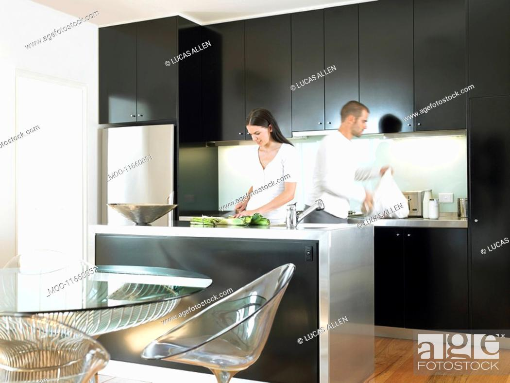Stock Photo: Couple in modern kitchen.