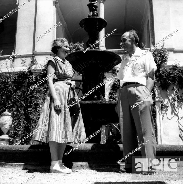 Stock Photo: Enrico Fermi and his wife Laura. At Monastero Villa at Varenna Enrico Fermi, Italian physicist, smiling with his wife Laura Capon. Varenna, July 1954.