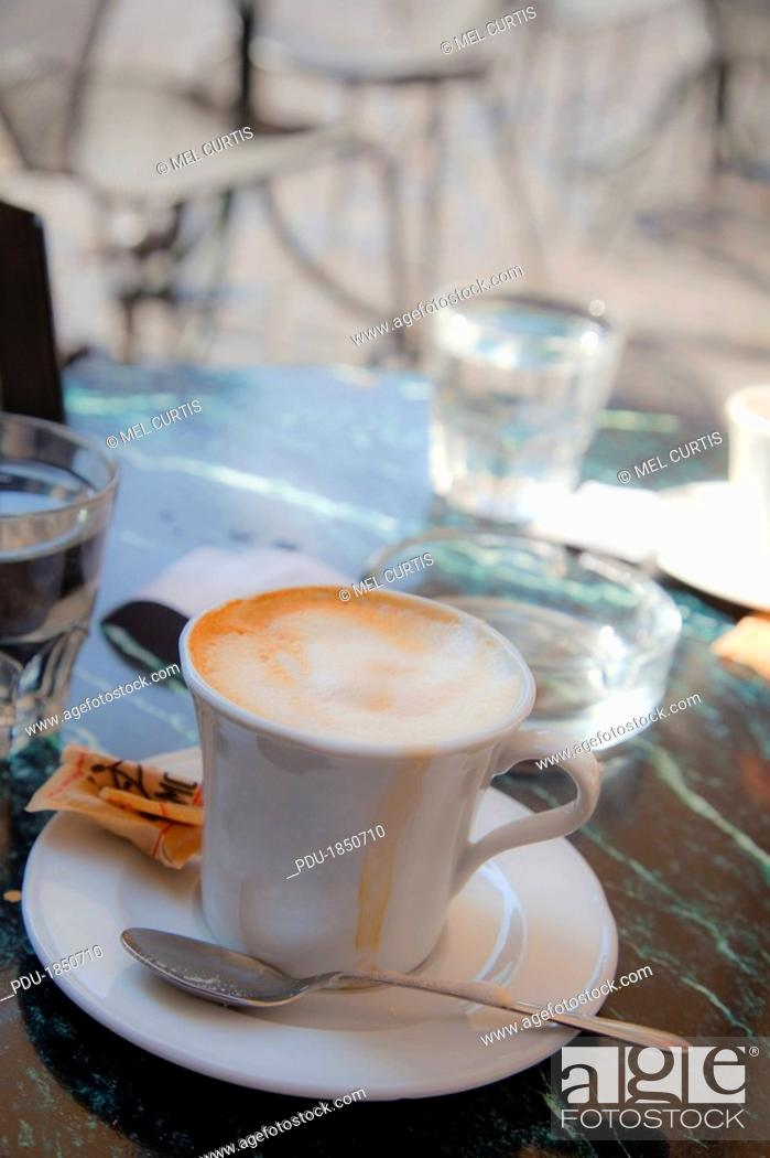 Stock Photo: Coffee cup at a cafe in Rome, Italy.