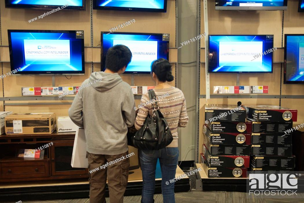 Shoppers Browse Flat Screen Televisions In A Best Buy In The
