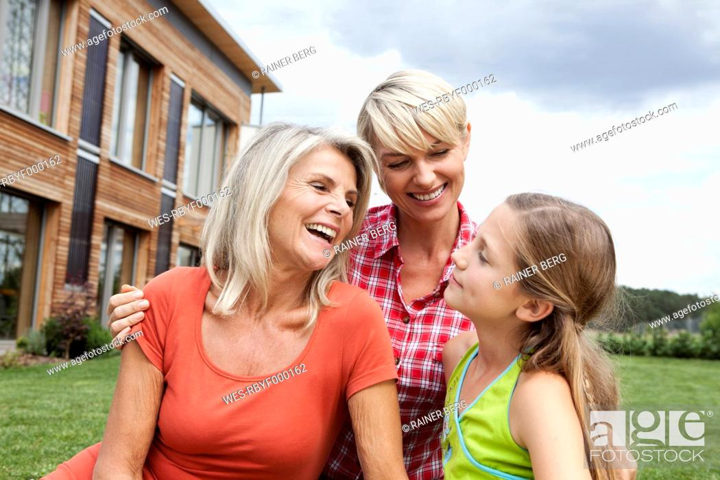 Stock Photo: Germany, Bavaria, Nuremberg, Family in front of house.