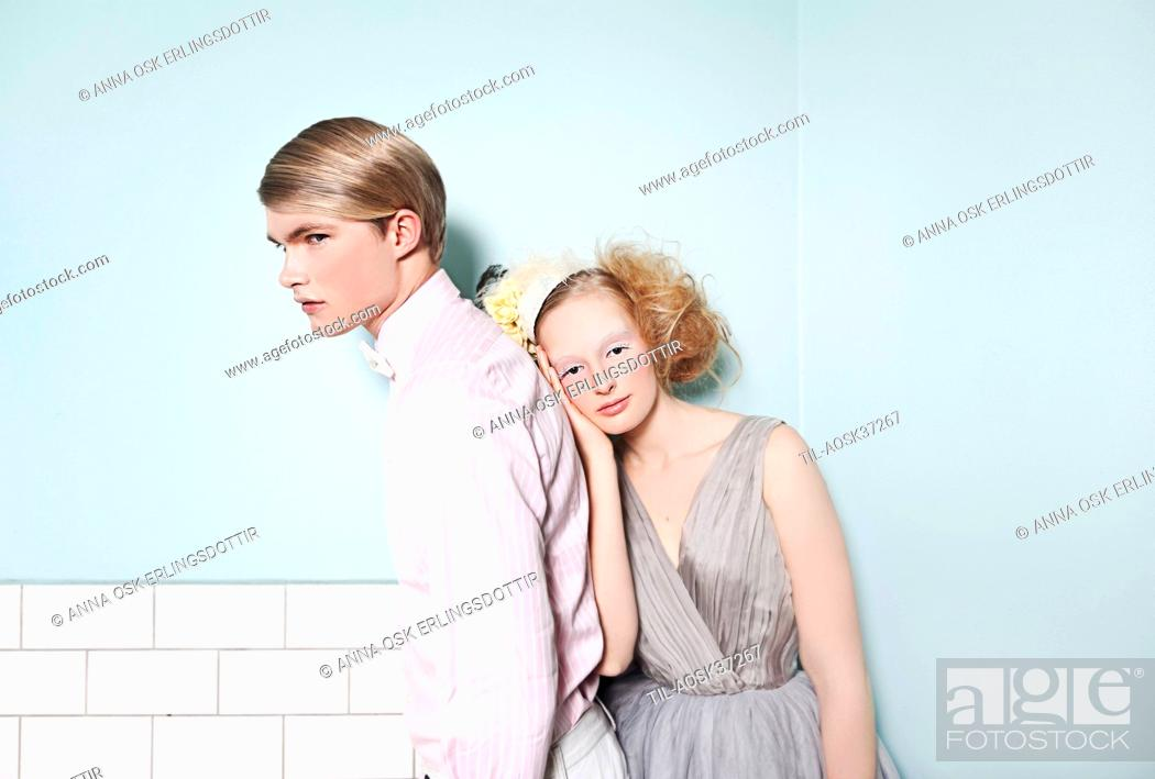 Stock Photo: Young man and young woman dressed for special occasion with smart appearance.