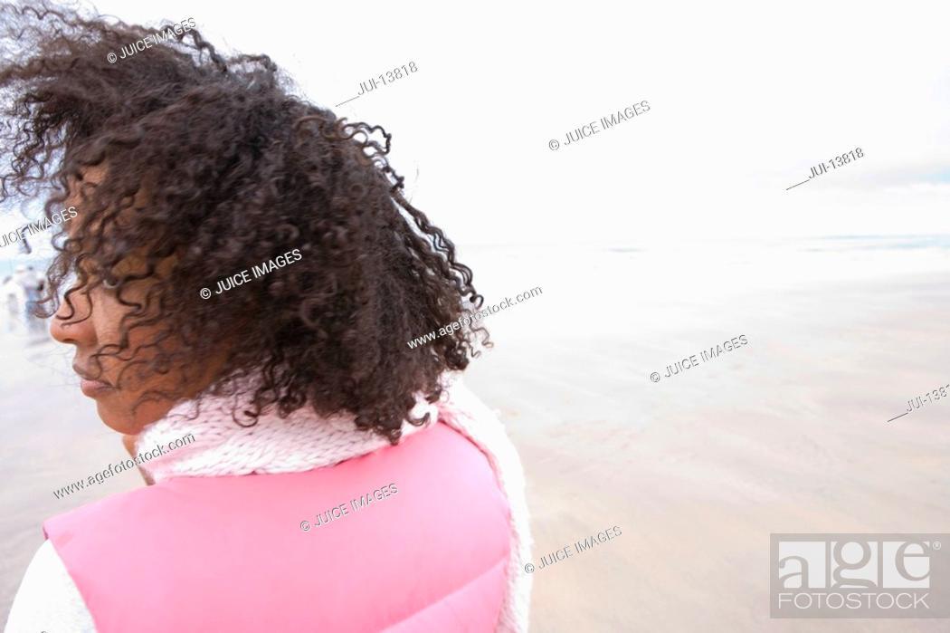 Stock Photo: Woman on beach, rear view.