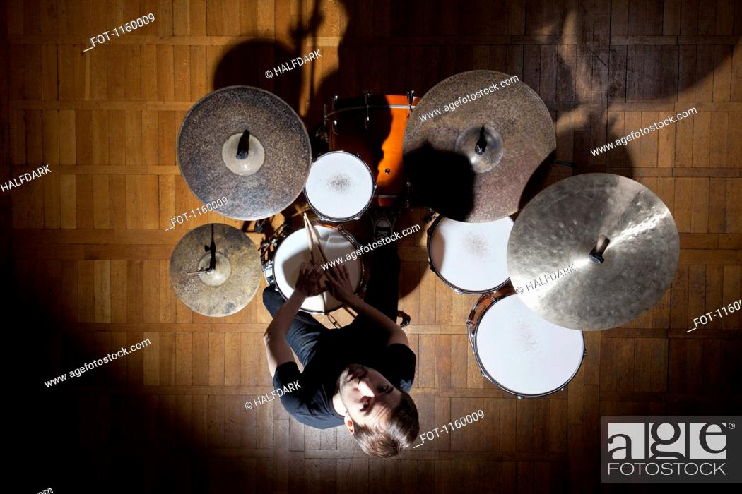 Stock Photo: Drummer looks up.