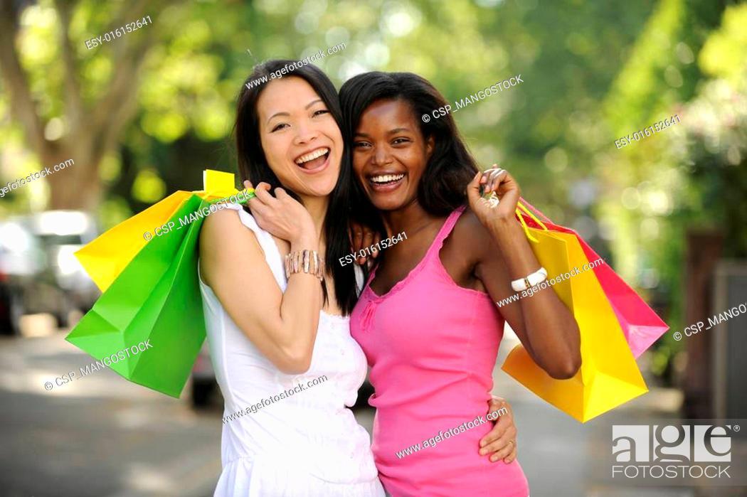 Stock Photo: happy multiethnic friends shopping.