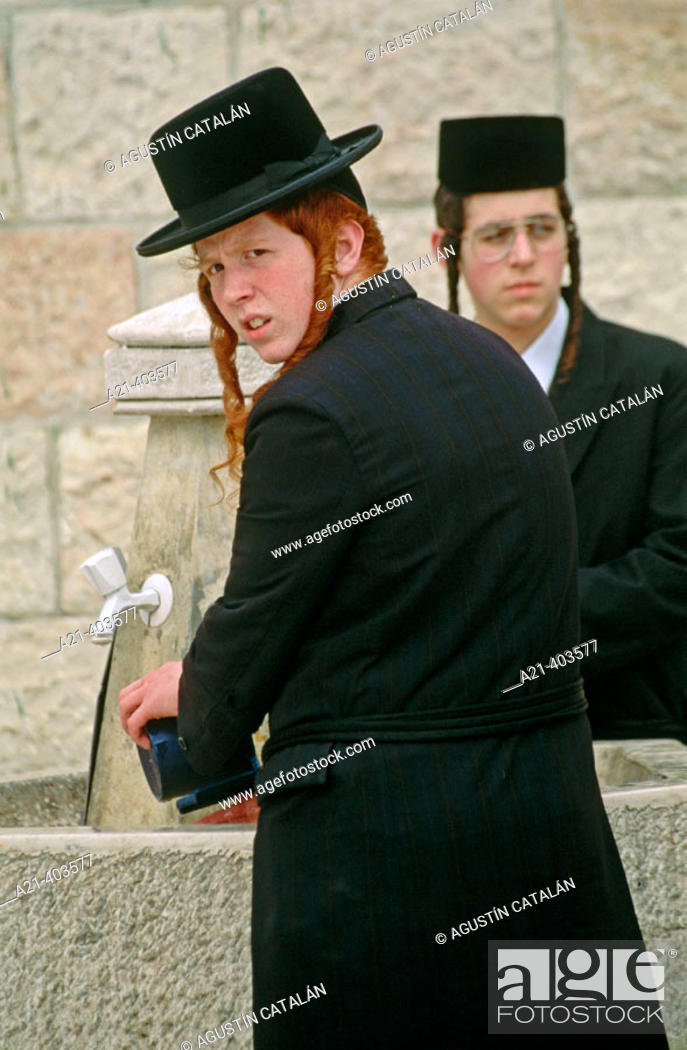Stock Photo: Young orthodox Jews washing their hands in a fountain. Jerusalem.