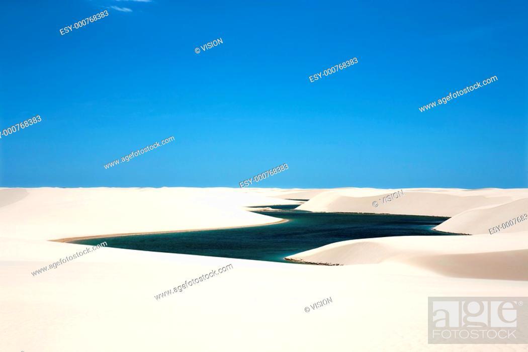 Stock Photo: view of lagoa azul in desert white sand dunes of the Lencois Maranheses National Park in brazil.