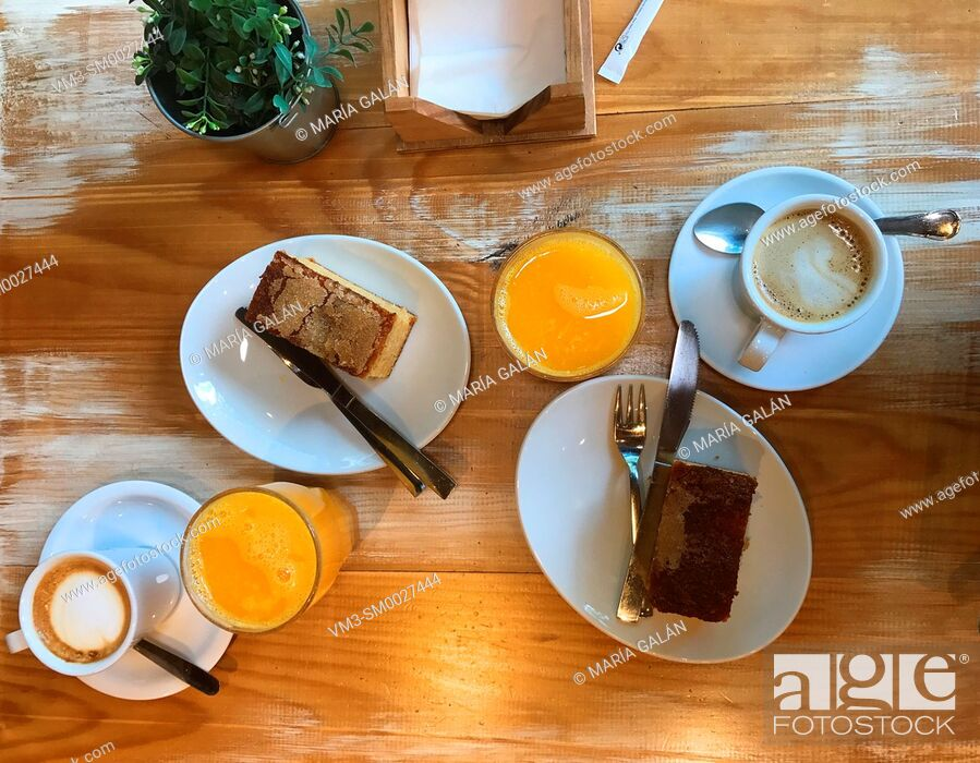 Stock Photo: Breakfast: cups of coffee, cakes and glasses of orange juice. View from above.