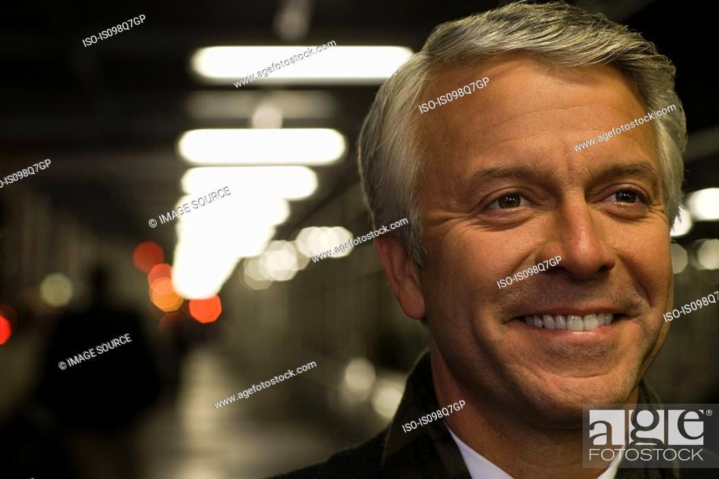 Stock Photo: Headshot of a smiling mature man.