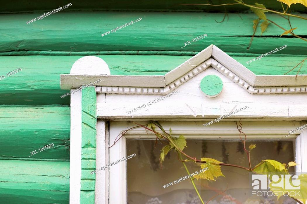 Stock Photo: Fragment of window decoration of a wooden country house  Russia.