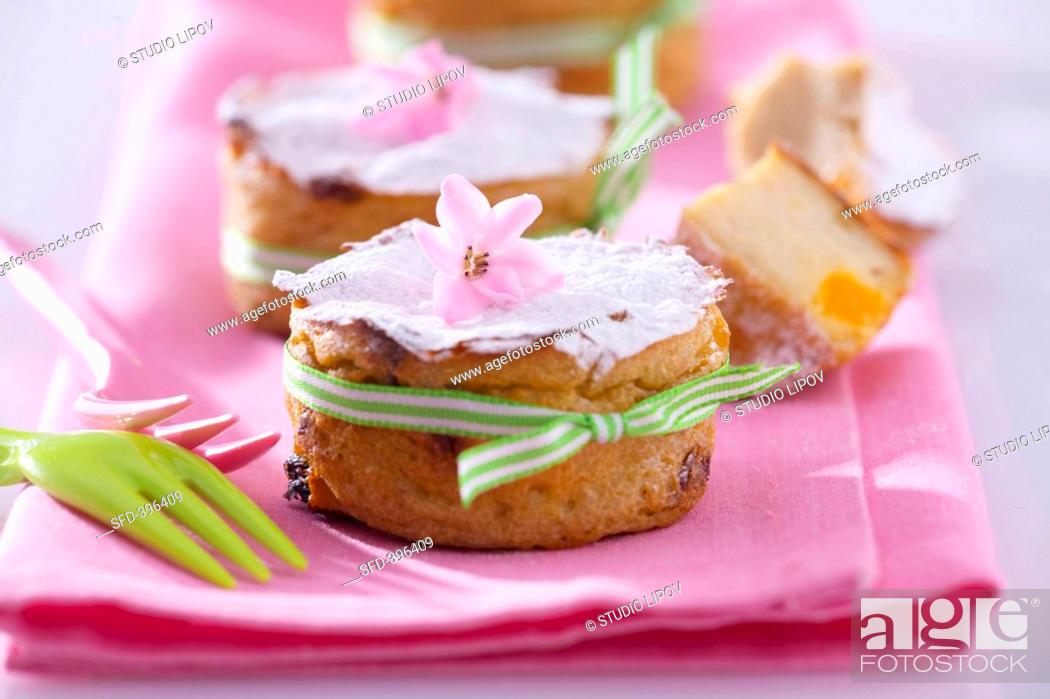 Stock Photo: Iced Easter muffins with flowers and bows.
